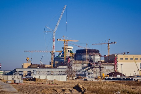 npp: Construction site. Construction of a new nuclear power plant. Cranes are working at building Stock Photo