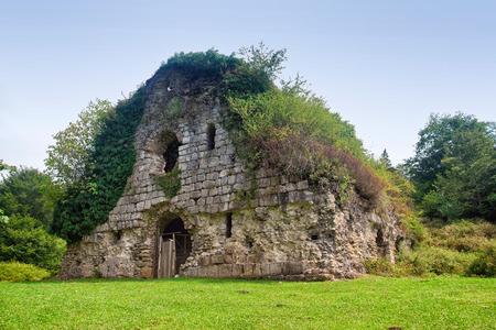 Overgrown ruins of ancient church VI-VII century, Abkhazia Stock Photo