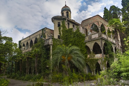 Abandoned and overgrown mansion in oriental style. Concept of Tale 1001 Arabian Nights. Sukhum, Abkhazia