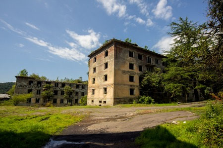 Abandoned mining ghost-town Polyana, Abkhazia. Destroyed empty houses, remnant of The Georgian-Abkhazian war Stock Photo