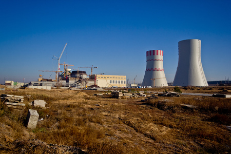 Construction site. Construction of a new nuclear power plant. Cranes are working at building Stock Photo