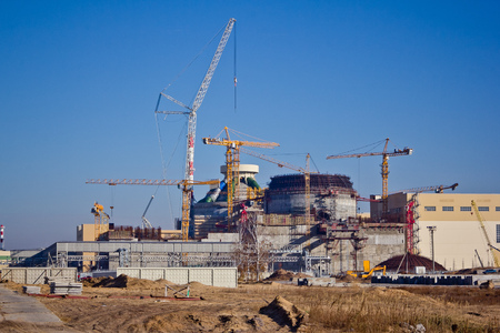 construction plant: Construction site. Construction of a new nuclear power plant. Cranes are working at building Stock Photo