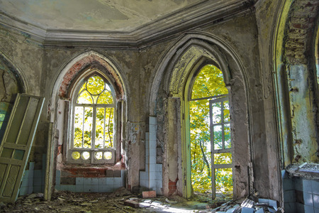 mystic place: Old room with rotten window and doorway of an abandoned castle of Khvostov in gothic style, Lipetsk region Stock Photo