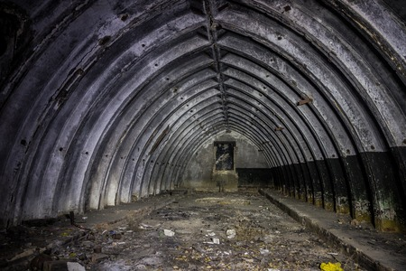 Abandoned and rotten bunker in Soviet military base Stock Photo