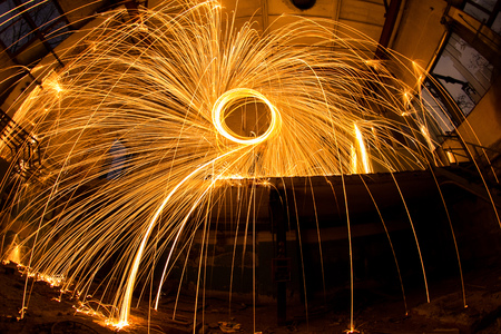 abandoned factory: Freezelight using spinning burning steel wool and pyrotechnics in abandoned factory Stock Photo