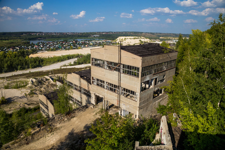 urban decay: Abandoned and overgrown crushing and screening Plant for Crushed Stone Production