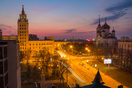Evening Voronezh. Tower of management of south-east railway in the style of Stalins empire and Annunciation Cathedral at sunset background Stock Photo