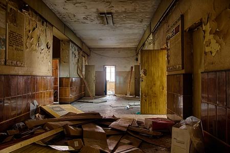 Old creepy corridor in abandoned Soviet hospital Stock Photo