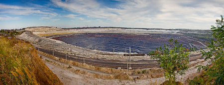 Panorama of the quarry for ore extraction. Pit of the Stoilensky Mining and Processing Plant Stock Photo