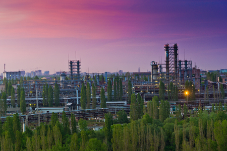 destilacion: Evening Voronezh cityscape. Summer crimson sunset at industrial area of Voronezh synthetic rubber plant