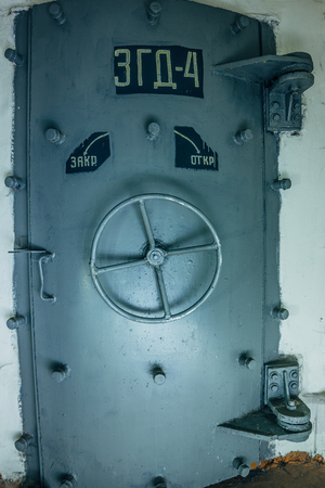 Closed hermetic door of an abandoned Soviet bomb shelter, an echo of the Cold War, Voronezh, Russia Archivio Fotografico