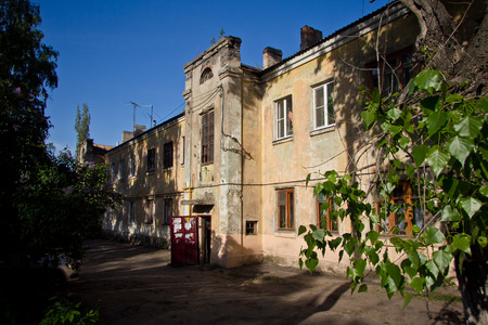 Old Soviet two storey house built by German prisoners after World War II in the late 40s and early 50s.