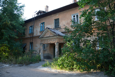 Old Soviet two-storied house with portico built by German prisoners after World War II in the late 40s and early 50s Stock Photo