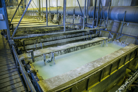 Galvanizing in etching acid containers in galvanic workshop Standard-Bild