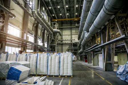 Packing area at chemical factory. Bags with chemical production Stock Photo