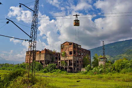 Abandoned train station, factory and cable car in Tquarchal (Tkvarcheli). Abkhazia, Georgia Stock Photo