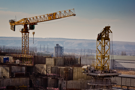 Construction of new nuclear power plant, working cranes