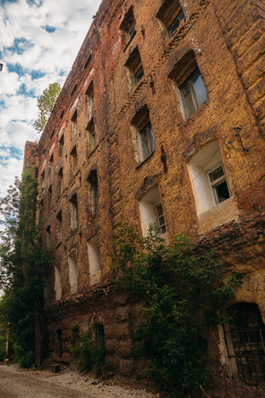 redbrick: Abandoned after fire historical factory building of red brick - former steam mill of Boberman, Samara, Russia Stock Photo