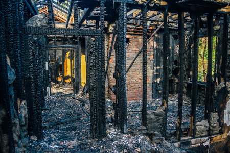 Interior of a burnt by fire apartment in an apartment building. Burned wooden beams