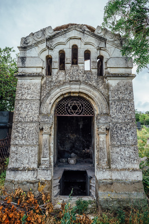 An old family-owned mausoleum, a crypt on an abandoned Jewish cemetery in Sevastopol