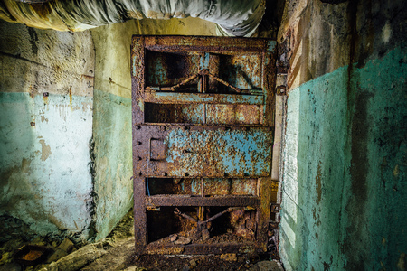 Old rusty steel armored door in abandoned soviet military bunker, Sevastopol