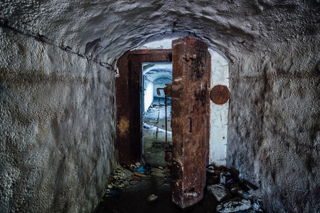 hermetic: Opened rusty armored hermetic door, entrance to abandoned Soviet warship ammunition depot under Sevastopol Stock Photo