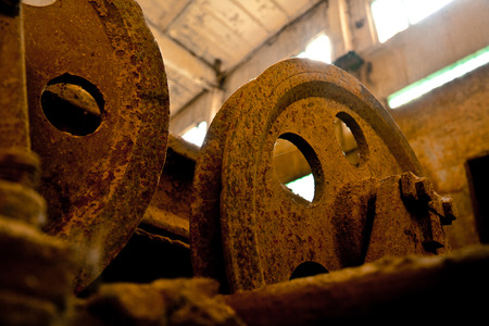 poleas: Close up view of old rusty pulleys in an abandoned factory