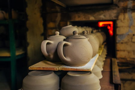 ceramicist: Firing of pottery in the oven Stock Photo