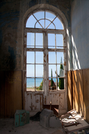 close uo: Old window overlooking the sea