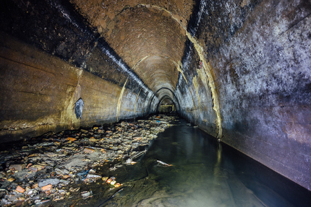 Big sewage collector. Dirty sewer tunnel under the city