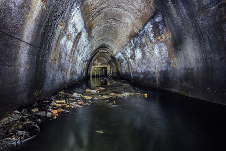 Flooded by wastewater sewage collector of underground river. Sewer tunnel under city Voronezh