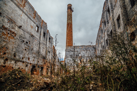 Ruined red brick industrial building. Abandoned and destroyed sugar factory in Novopokrovka, Tambov region Stock Photo