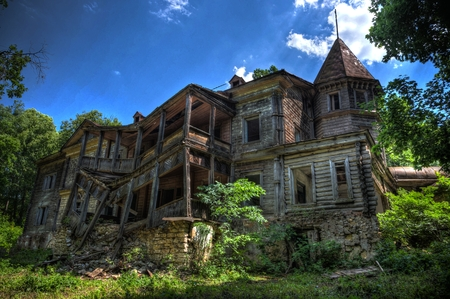Creepy haunted rotten abandoned wooden palace. Former mansion of earl Naryshkin in Bikovo, Ryazan region Stock Photo