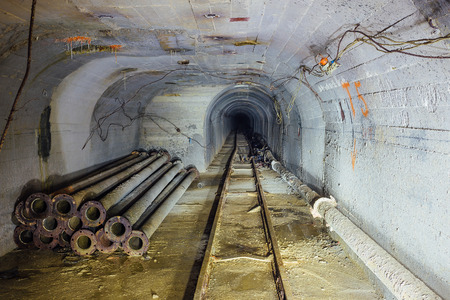 Technical tunnel with narrow-gauge railway and construction of pipeline of heating main