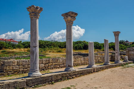 Old Greek columns remains of ancient Byzantian basilica. Old ruins in archaeological park Chersonesus