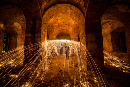 steel wool: Freezelight using spinning burning steel wool and pyrotechnics in the ruins of castle. Trajectories of burning sparks