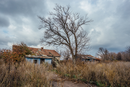 Abandoned creepy forgotten Russian village. Old abandoned wooden houses.