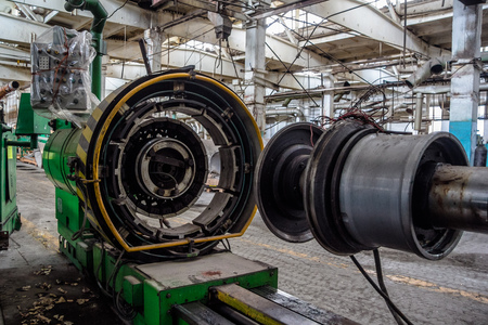 Abandoned old auto tire factory with rusted machine tools. Abandoned tire manufacturing. Stock Photo