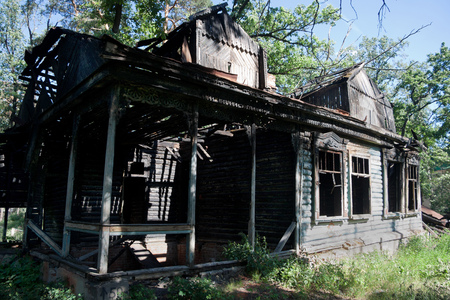 Burned rural house after fire in Russian village.