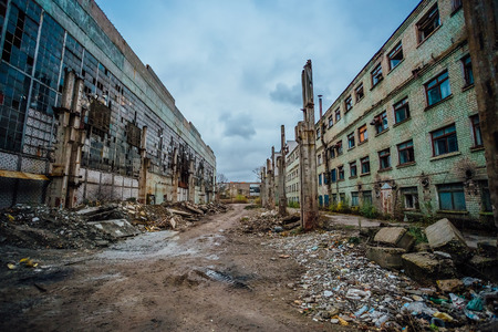 Territory of abandoned industrial area waiting for demolition. Junk at former Voronezh excavator factory. Stock Photo