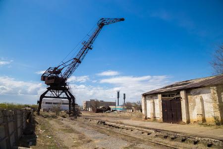 Old rusty crane in abandoned industrial area, former Aral port, Kazakhstan