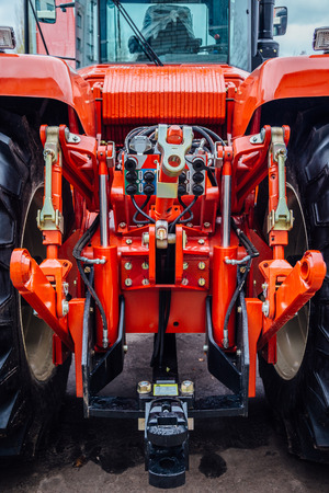 Rear view of modern agricultural tractor. Hydraulic hitch. Lifting frame. Rear mechanism for attaching trailed equipment.