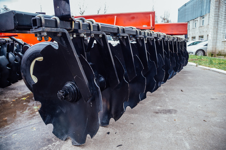 New modern agricultural disc harrow. Tillage equipment.
