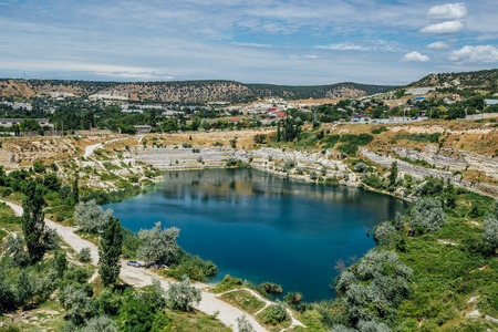 Flooded quarry in Crimea. Blue pond on the place of former whiter limestone mine.
