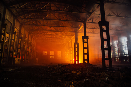 Fire in the factory. Burned by fire industrial building. Stock Photo