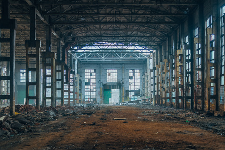 Dark ruined rotten abandoned large industrial hall. Voronezh excavator factory Standard-Bild