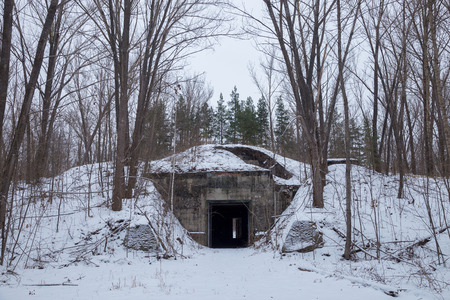 Winter. Hidden in the forest entrance to the secret soviet military bunker, echo of cold war.