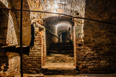 Underground vaulted cellar of red brick under old mansion. Stock fotó