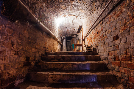 Underground vaulted cellar of red brick under old mansion. Stock Photo