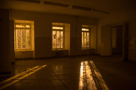 Sinister and creepy interior of abandoned and rotten hospital.
